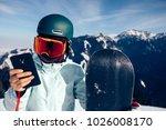 one snowboarder use smatphone...   Shutterstock . vector #1026008170