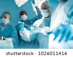 cropped image of doctor passing ... | Shutterstock . vector #1026011416