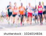 marathon runners in the city  | Shutterstock . vector #1026014836