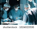 multiethnic surgeons in medical ... | Shutterstock . vector #1026023530