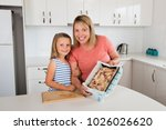 young mother and her sweet... | Shutterstock . vector #1026026620