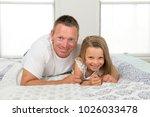 young caucasian man  lying on... | Shutterstock . vector #1026033478
