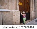 little girl knocking in a... | Shutterstock . vector #1026050404