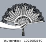 female hand with open fan.... | Shutterstock .eps vector #1026053950