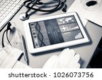 white tablet pc and doctor... | Shutterstock . vector #1026073756