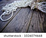 rope bundled up on a worn... | Shutterstock . vector #1026074668
