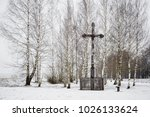 old wooden cross in a small... | Shutterstock . vector #1026133624