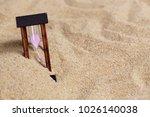 hourglass on the sea sand beach....   Shutterstock . vector #1026140038