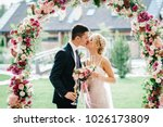 the bride and groom kissing.... | Shutterstock . vector #1026173809