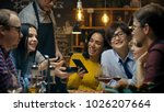 in the bar waiter holds credit... | Shutterstock . vector #1026207664