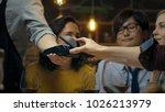 in the bar waiter holds credit... | Shutterstock . vector #1026213979