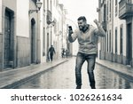 exultant young man in the... | Shutterstock . vector #1026261634