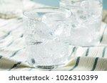 fresh spring sparkling water... | Shutterstock . vector #1026310399