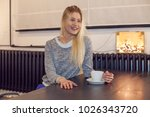 young woman drinking tea in... | Shutterstock . vector #1026343720