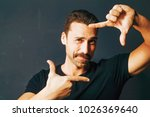 young adult man with moustache... | Shutterstock . vector #1026369640