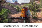 backpacker hiker man treks... | Shutterstock . vector #1026408454