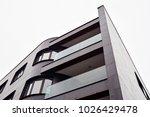 facade of a modern apartment... | Shutterstock . vector #1026429478