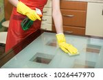 housekeeper washing glass table ... | Shutterstock . vector #1026447970