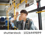 asian man taking public... | Shutterstock . vector #1026449899