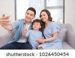 family selfie. happy vietnamese ... | Shutterstock . vector #1026450454