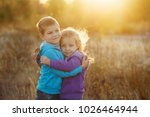 family time. brother and sister ... | Shutterstock . vector #1026464944