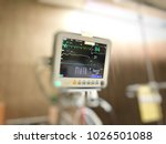 Stock photo selective focus display screen of vital signs monitor in the hospital medical equipment 1026501088