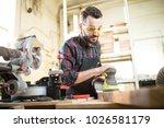 young caucasian carpenter  in ... | Shutterstock . vector #1026581179