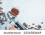 Portafilter with scattered ground coffee close-up. Equipment for brewing coffee on a light background with copy space. - stock photo