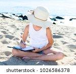 child girl in hat writes draws... | Shutterstock . vector #1026586378