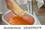 wax bath for feet at beauty spa ... | Shutterstock . vector #1026594379