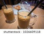 delicious ice milk coffee at...   Shutterstock . vector #1026609118