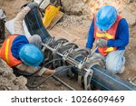Construction site water supply project at working for welding the connecting of HDPE pipe by blue color uniform constructor - stock photo