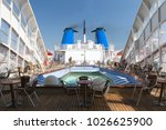 IZMIR ,TURKEY - AUGUST 24, 2017:  View of top deck of cruise ship with luxurious pools and spa facilities. Cruise liner is passenger ship used for pleasure voyages. - stock photo