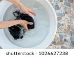 woman hands washing of bra in... | Shutterstock . vector #1026627238