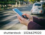woman using cellphone and... | Shutterstock . vector #1026629020
