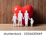 close up of a family holding... | Shutterstock . vector #1026630469