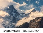 high mountains with snowy peaks ...   Shutterstock . vector #1026632254