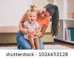 happy mother and daughter... | Shutterstock . vector #1026653128