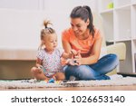 mother and daughter in their... | Shutterstock . vector #1026653140