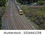 Small photo of Taringa, Brisbane, Australia - February 2018: Suburban electric train leaving Taringa station