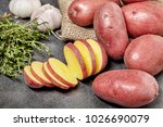 red potato on black wood table... | Shutterstock . vector #1026690079