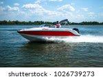indoor motor boat on the river. ... | Shutterstock . vector #1026739273
