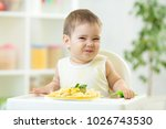 funny baby boy eating healthy... | Shutterstock . vector #1026743530