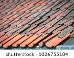 old tiled roof. top of building....   Shutterstock . vector #1026755104