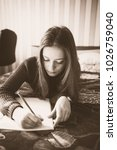 young girl study for exams | Shutterstock . vector #1026759040