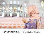 Young Muslim Woman Praying In...