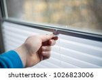 pulling up pleated shades on...   Shutterstock . vector #1026823006