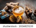 yellow colored lemon ginger tea ... | Shutterstock . vector #1026825133