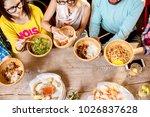 friends eating asian food... | Shutterstock . vector #1026837628