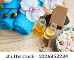 spa setting with oils  towels... | Shutterstock . vector #1026853234